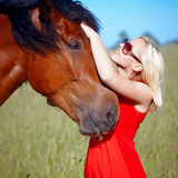 Girl and horse. Portrait of the girl embracing a horse Stock Photo