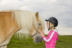 Girl and horse Royalty Free Stock Image