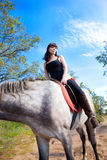 Girl on horse background of blue Royalty Free Stock Images