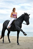 Girl and  horse on the beach Stock Images