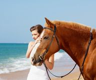 Girl with horse on the beach Royalty Free Stock Photos