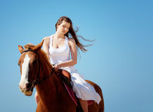 Girl with horse on the beach Stock Images