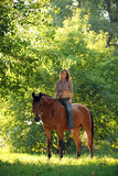 Girl on a horse country riding. Cowgirl at bareback horse riding Royalty Free Stock Photo