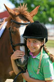 Girl and horse. Cute happy girl and her pony or horse Stock Photo