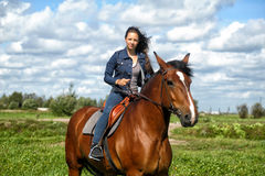 Girl  on a horse Royalty Free Stock Photos