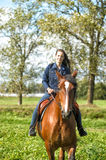 Girl  on a horse Royalty Free Stock Images