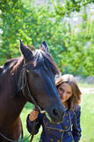 A girl with a horse Royalty Free Stock Photo