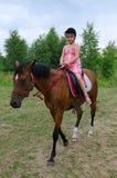 Girl horse riding Stock Photo