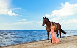 Girl with horse on seacoast Stock Image