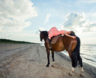 Girl with horse on seacoast Royalty Free Stock Photography