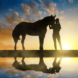 Girl with a horse Royalty Free Stock Image