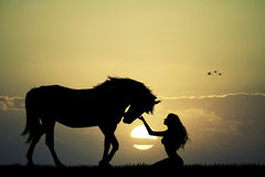 Girl an horse at sunset Royalty Free Stock Images