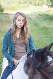 Girl on horse royalty free stock image