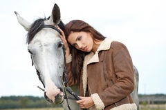 Girl and horse Royalty Free Stock Photo