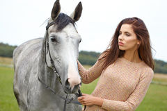 Girl and horse Royalty Free Stock Photos