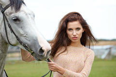 Girl and horse Stock Images