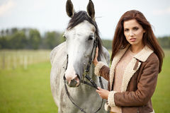 Girl and horse Stock Photos