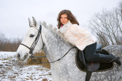 Girl on a horse.winter landscape Stock Photos