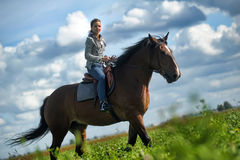 Girl  on a horse Royalty Free Stock Photography