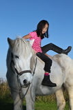 Girl on a horse Stock Photography