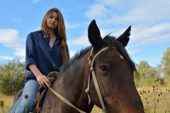 Girl on horseback Stock Photos