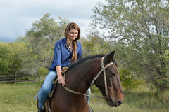 Girl on horseback Stock Images