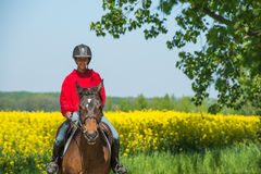 Girl on horseback riding Royalty Free Stock Photos