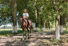 Girl on horseback riding Royalty Free Stock Image