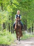 Girl on horseback riding Stock Photo