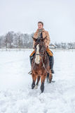 Girl on horseback in the winter on snow Royalty Free Stock Photo