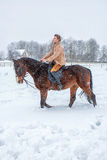 Girl on horseback in the winter on snow Stock Photos