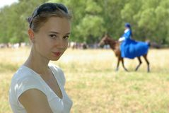 Girl and a horsewoman Stock Photos