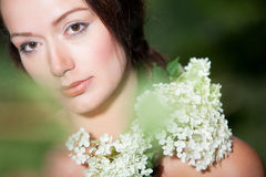 Girl with hortensia on her shoulder Stock Photo