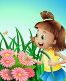 A girl with a hose at the garden Stock Images