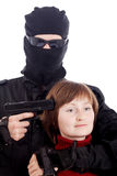 Girl hostage. Terrorist in a traditional clothing and a hostage Stock Photo