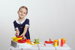 Girl hostess prevents spoon in the pan Stock Image