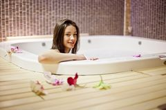 Girl in hot tub Stock Image
