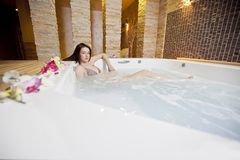 Girl in hot tub Stock Image