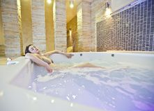 Girl in hot tub Stock Photography