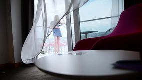 Girl on hotel`s balcony stock video