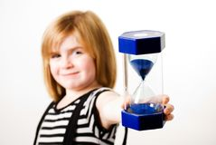 Girl with hourglass Royalty Free Stock Images