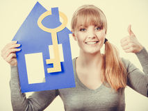 Girl with house approves. Royalty Free Stock Images