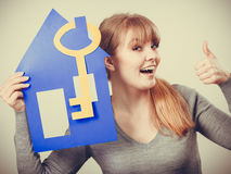 Girl with house approves. Stock Photo