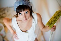 The girl the house painter Stock Images