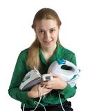 Girl with household appliances. Young woman in green with household appliances Royalty Free Stock Images