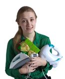 Girl with household appliances and present. Young woman in green with household appliances and present Royalty Free Stock Images