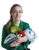 Girl with household appliances and present. Young woman in green with household appliances and present Stock Images