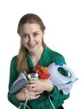 Girl with household appliances and present. Young woman in green with household appliances and present Royalty Free Stock Photography