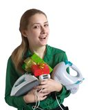 Girl with household appliances and present. Young woman in green with household appliances and present Stock Photo