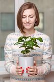 Girl with houseplant Stock Photography